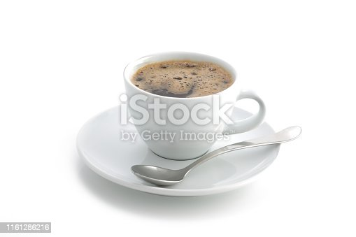 A white coffee cup and saucer and spoon black coffee isolated on a white background