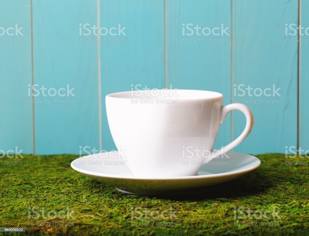 White coffee cup on green grass - Royalty-free Black Color Stock Photo