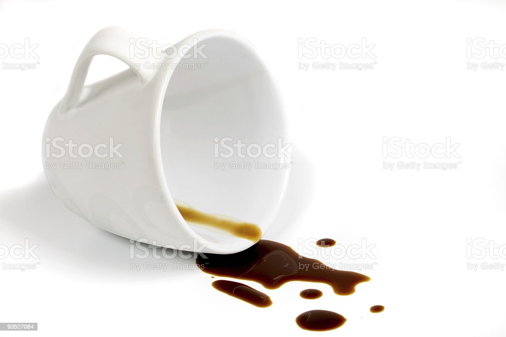 White coffee cup tipped over spilling some coffee stock photo