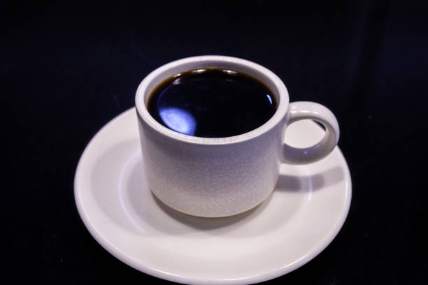 White Coffee Cup with Americano black coffee on black stock photo