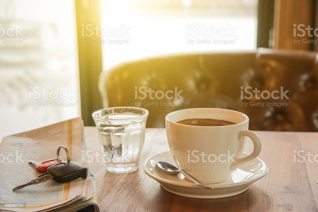 White coffee cup,Newspaper,car key  and glass water. royalty-free stock photo