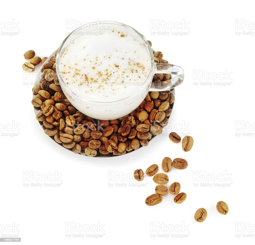 White coffee in glass cup and saucer filled with beans royalty-free stock photo