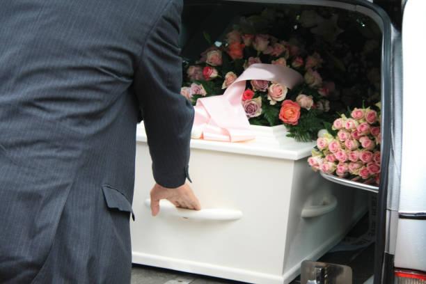 white coffin in a grey hearse - funerale foto e immagini stock