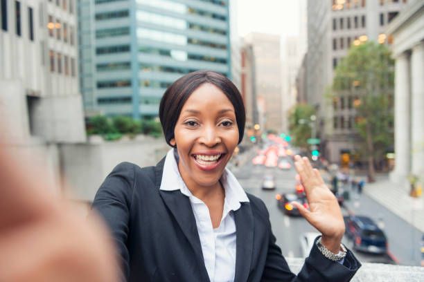 White collar African American woman taking selfie stock photo