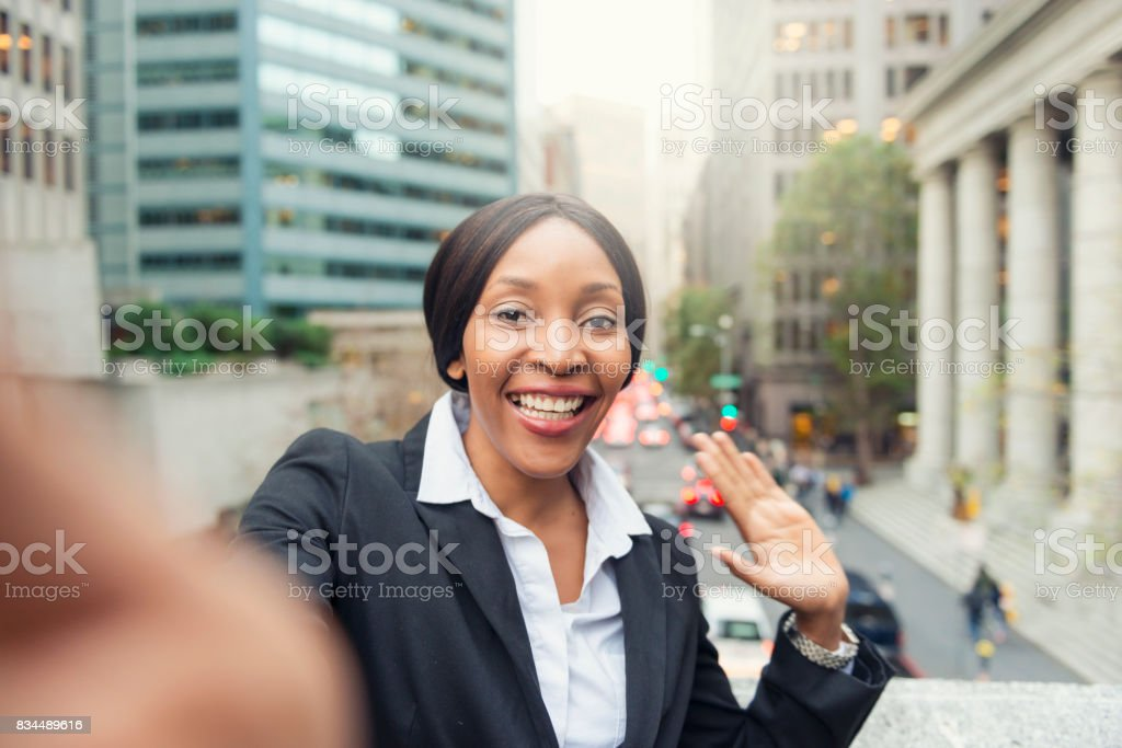 White collar African American woman taking selfie stock photo