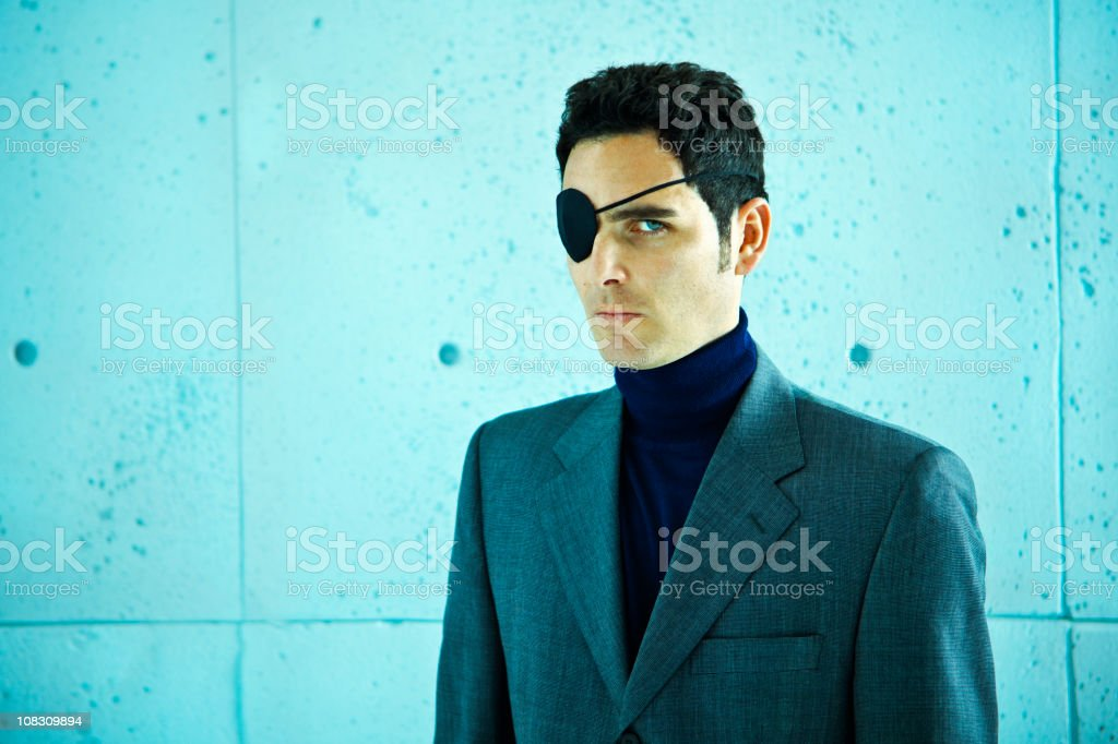 White collar crime: businessman with eye patch royalty-free stock photo
