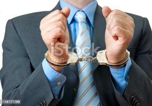 istock White collar criminal under arrest 148121299