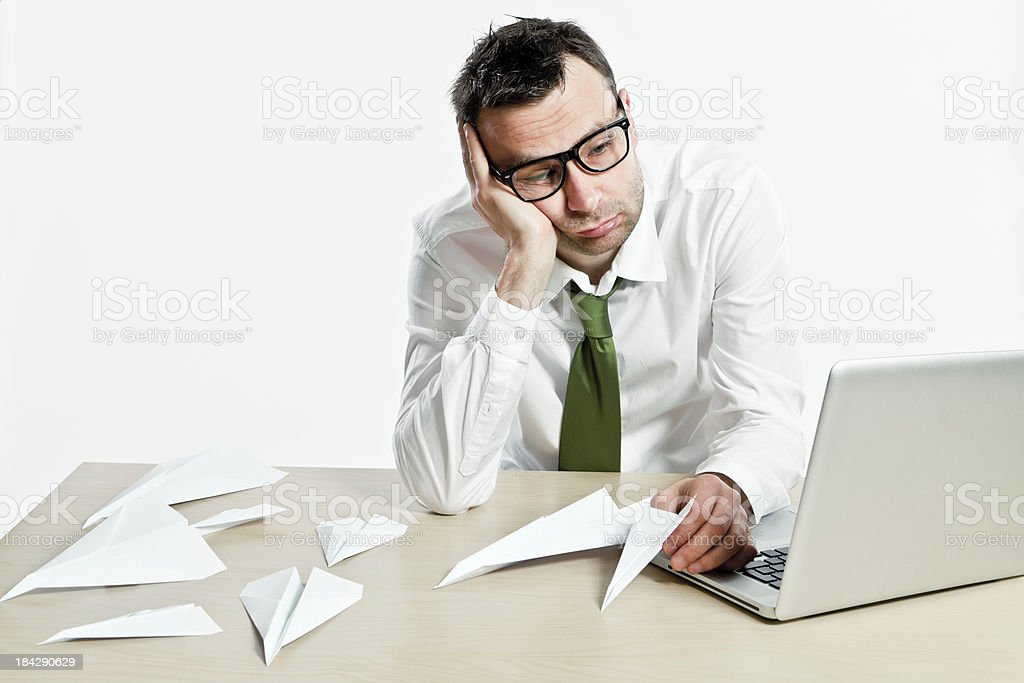 White collar office worker boring and made paper airplanes royalty-free stock photo