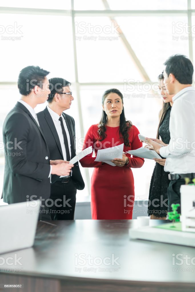 White collar worker discuss the details of the project stock photo