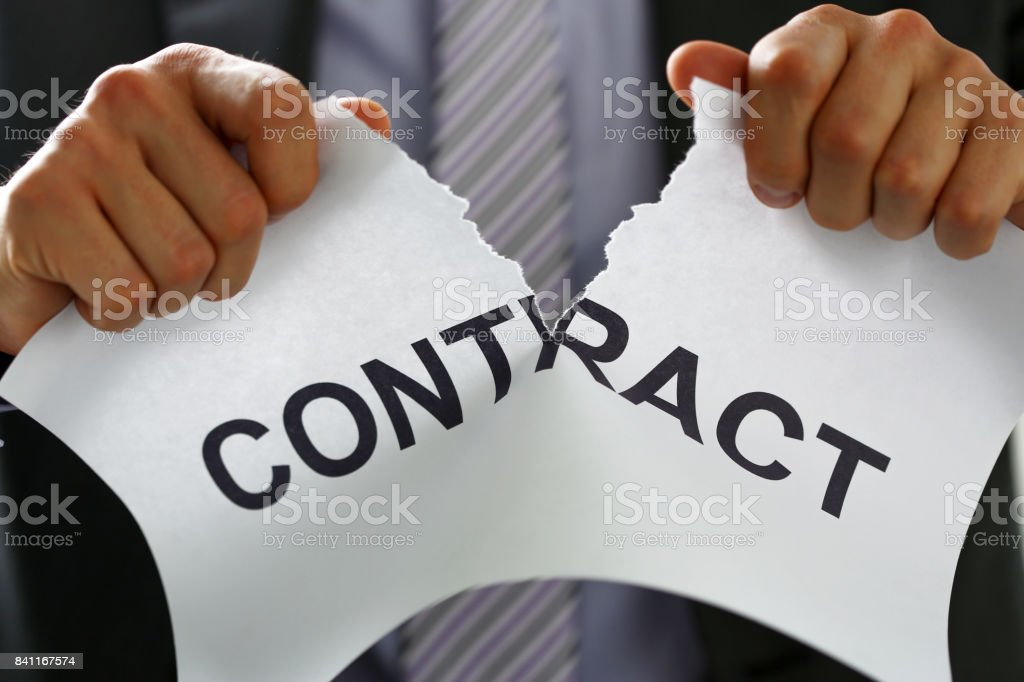 White collar worker in suit and tie tear contract stock photo