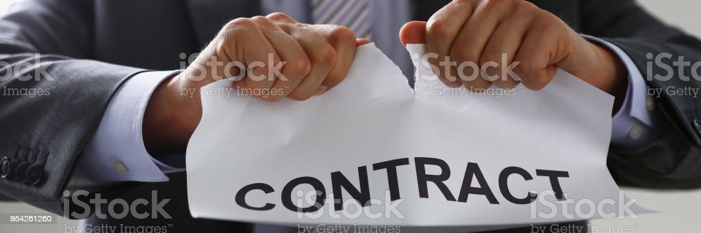 White collar worker in suit and tie tear stock photo