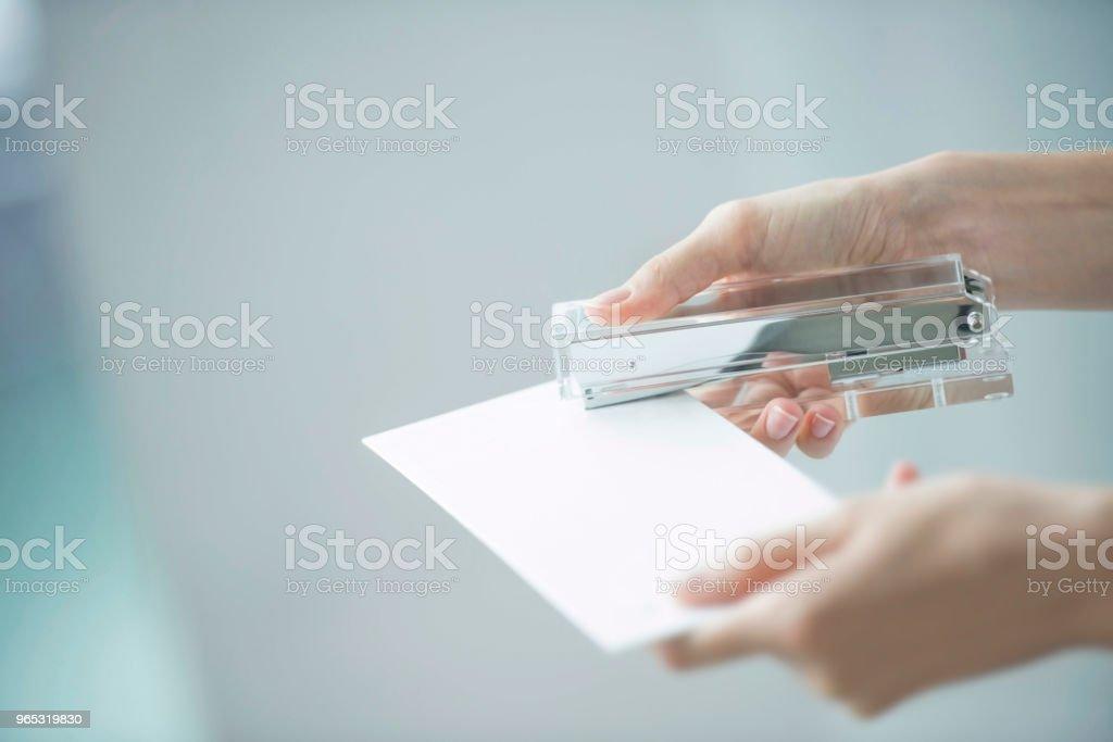 Stapling white document zbiór zdjęć royalty-free