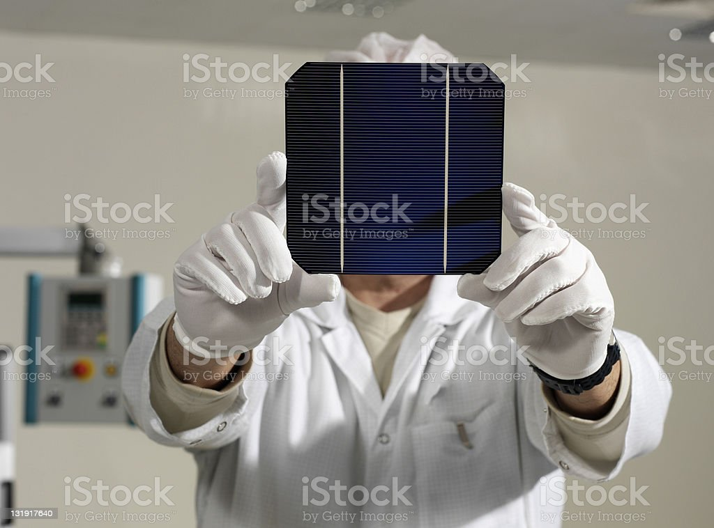 white collar worker with solar panel royalty-free stock photo