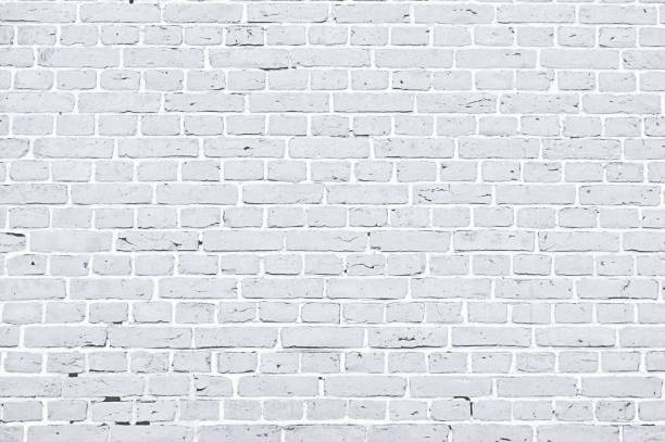 A white color brick wall with rectangular blocks, textured background stock photo