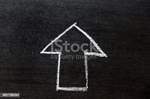 istock White color chalk hand drawing as arrow shape on black board background 950796594