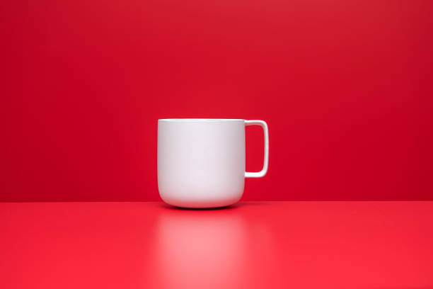 white color coffee or tea cup on red background stock photo