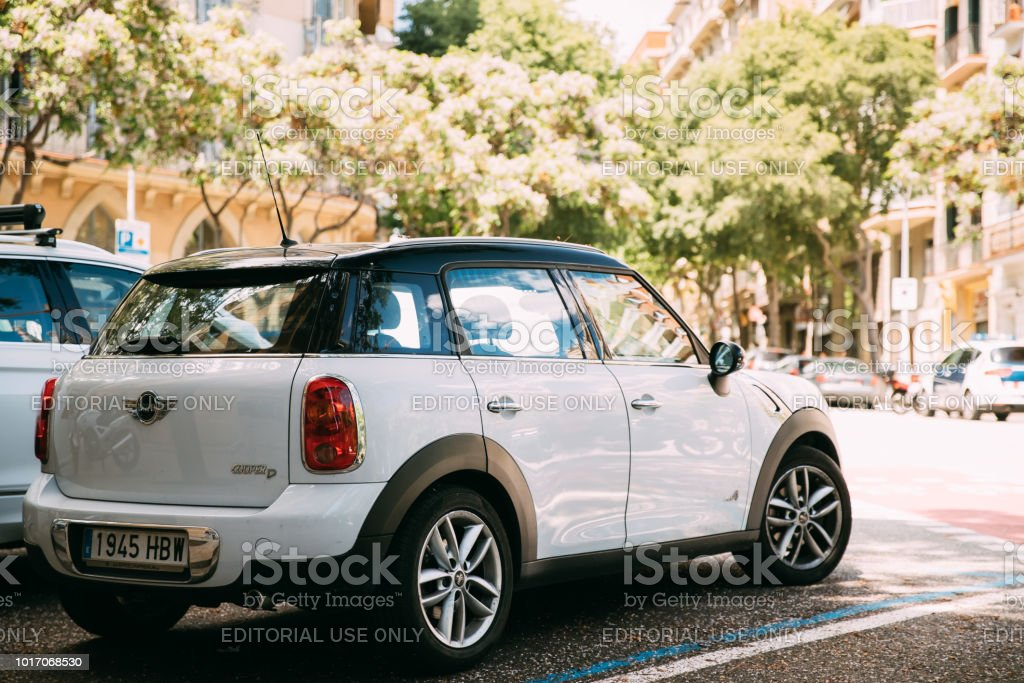White Color Mini Cooper All 4 Car Parking In Street - Royalty-free BMW Stock Photo