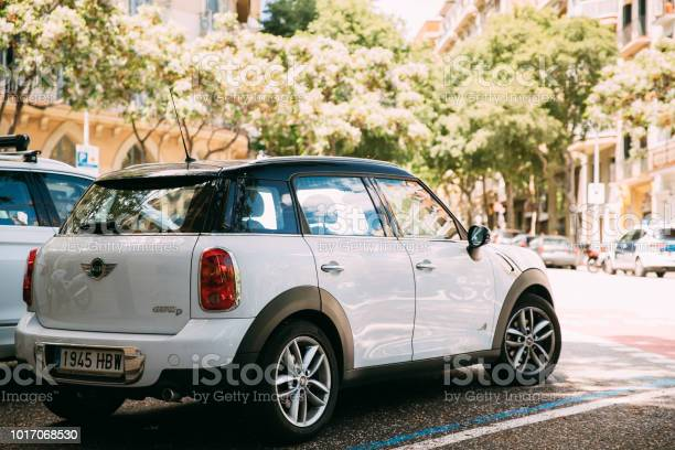 White Color Mini Cooper All 4 Car Parking In Street Stock Photo - Download Image Now