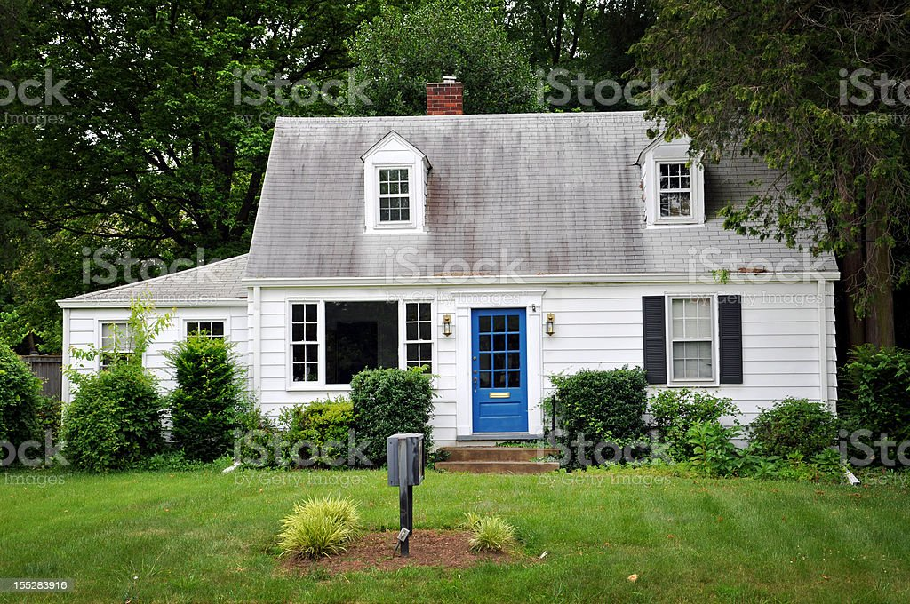 White colored house with blue door stock photo
