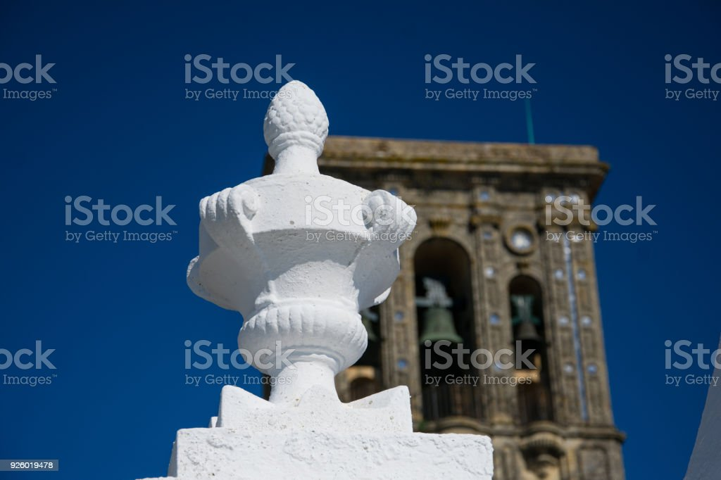 White Column decoration with the Church of Santa Maria in the background stock photo