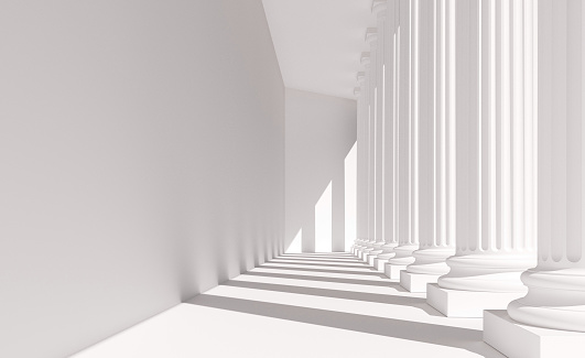 Classical white columns in a row casting shadows on a wall. Abstract architecture resembling a government building dedicated to law, justice and education. Digital image.