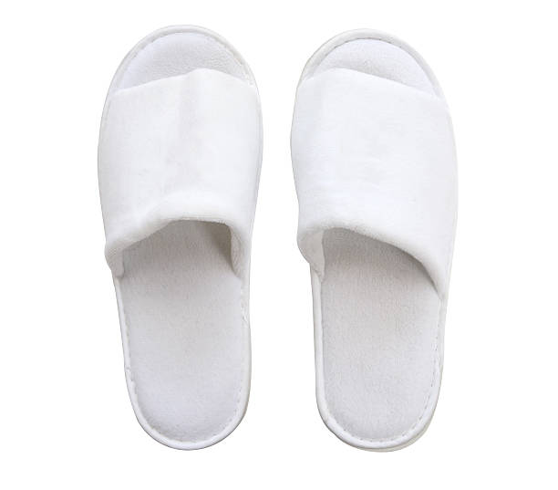 white comfortable slippers isolate (clipping path) stock photo