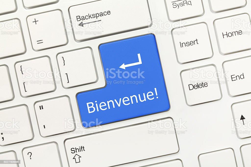 White conceptual keyboard - Bienvenue (blue key) stock photo