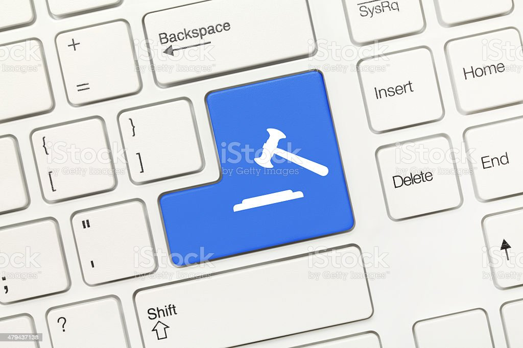 White conceptual keyboard - Blue key with gavel symbol stock photo