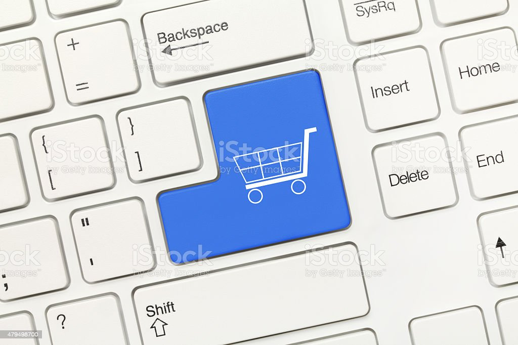 White conceptual keyboard - Blue key with shopping cart symbol stock photo