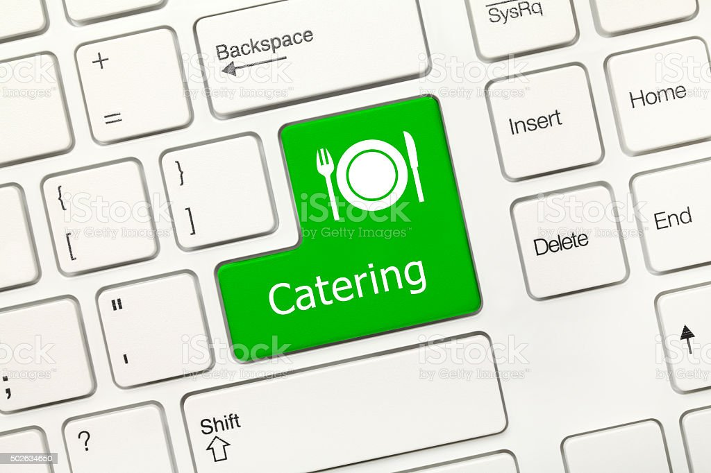 White conceptual keyboard - Catering (green key) stock photo