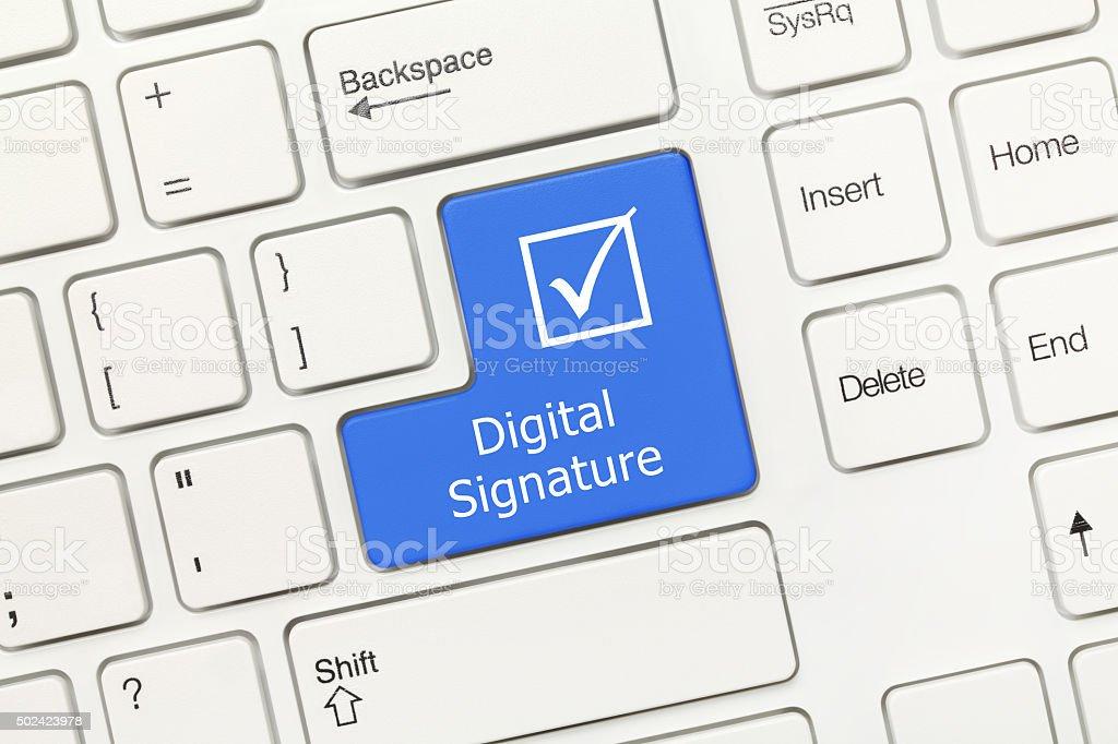 White conceptual keyboard - Digital Signature (blue key) stock photo
