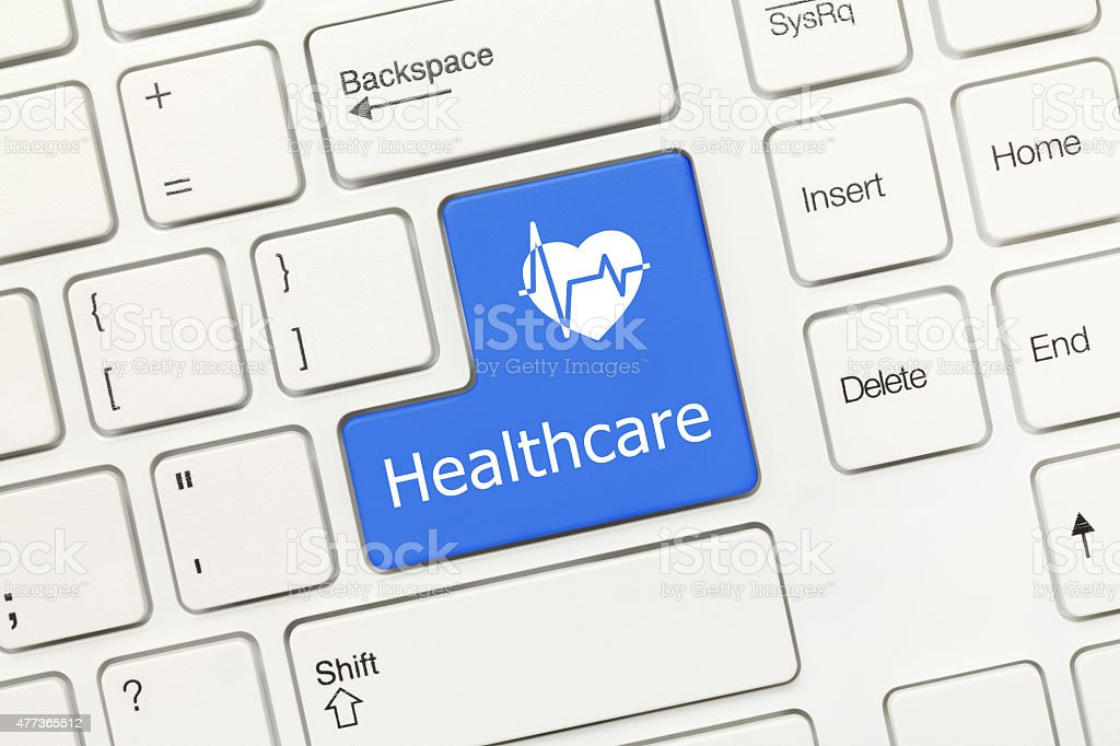 White conceptual keyboard - Healthcare (blue key) stock photo