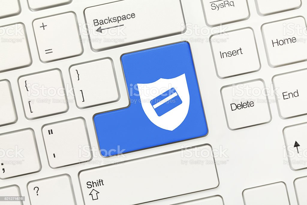 White conceptual keyboard - Key with shield and card symbols stock photo