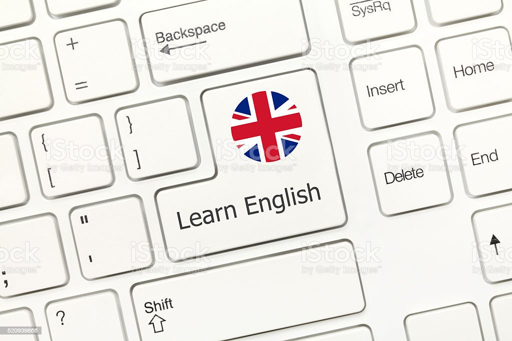 White conceptual keyboard - Learn English (key with national flag) stock photo