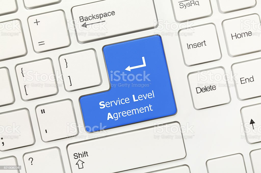 White conceptual keyboard - Service Level Agreement (blue key) stock photo