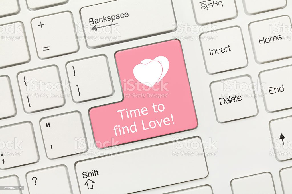 White conceptual keyboard - Time to find Love (pink key) stock photo