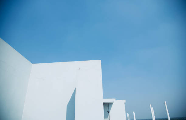 White concrete building with blue sky background stock photo
