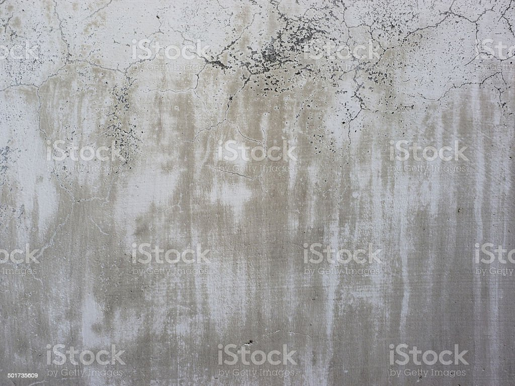 white concrete cracked wall stock photo