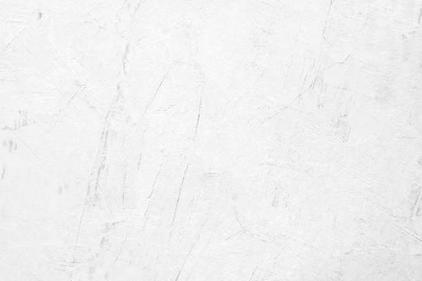 White concrete stone paint wall background, Grunge cement paint texture backdrop, White rough concrete stone wall background, Copy space for interior design background, banner, wallpaper stock photo