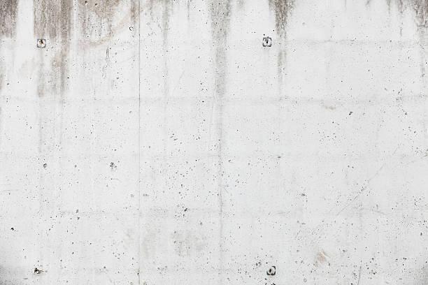 white concrete wall, background texture - tupfen wände stock-fotos und bilder