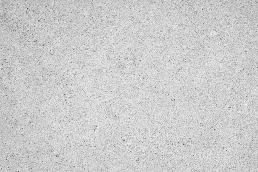 White concrete wall for interiors or outdoor exposed surface polished concrete. Cement have sand stone of tone vintage, natural patterns old antique, design art work floor texture background. concrete texture, concrete wall, concrete floor, Loft concrete.