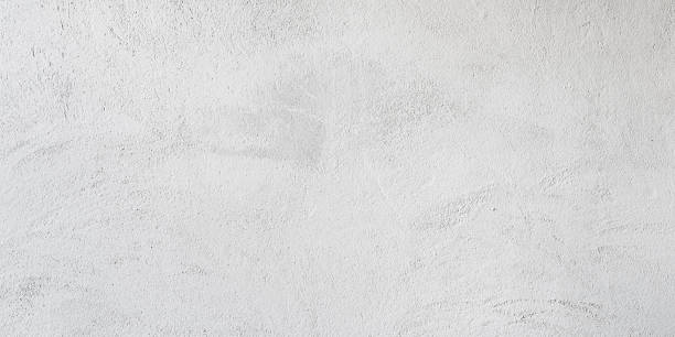 White concrete wall Texture of a white concrete wall for background surrounding wall stock pictures, royalty-free photos & images
