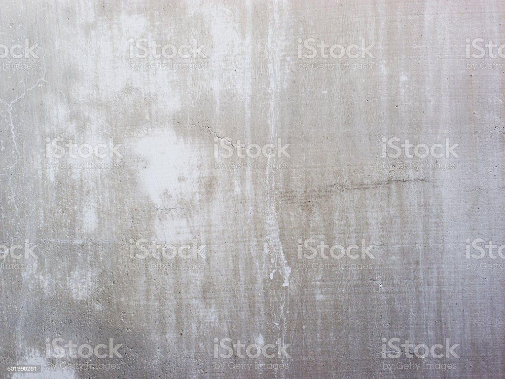 white concrete wall with water based stain stock photo