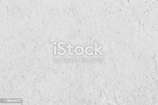 istock White concreted wall for interiors or outdoor exposed surface polished concrete. 1136946207