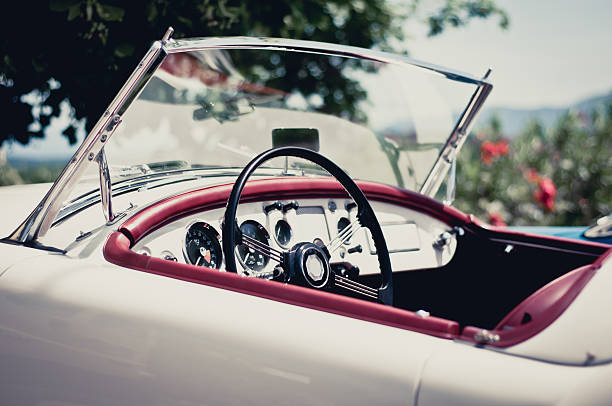 white convertible with red accents on a sunny day - classic cars stock photos and pictures