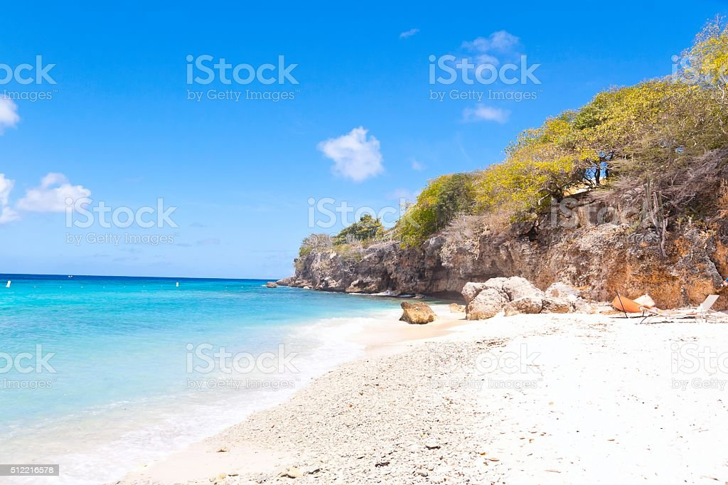 White Coral Beach on a Rocky Bay stock photo