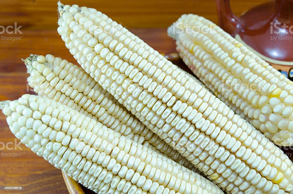 White corn in a vintage clay plate stock photo