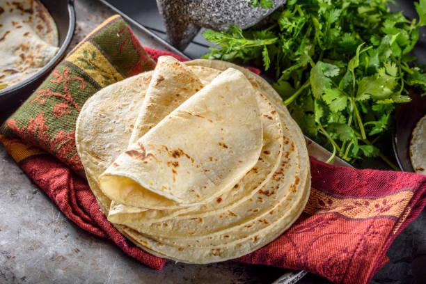 white corn tortilla - tortilla stock photos and pictures