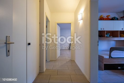 istock White corridor with built-in closets and open doors 1010083432