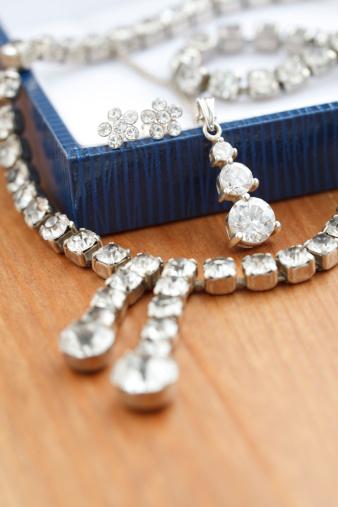 istock White costume jewelry on gift box 176114500